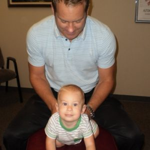 Chiropractor Naperville IL Timothy Erickson adjusting infant