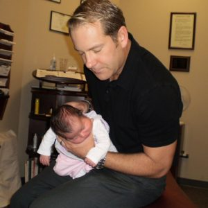 Chiropractor Naperville IL Timothy Erickson with Child